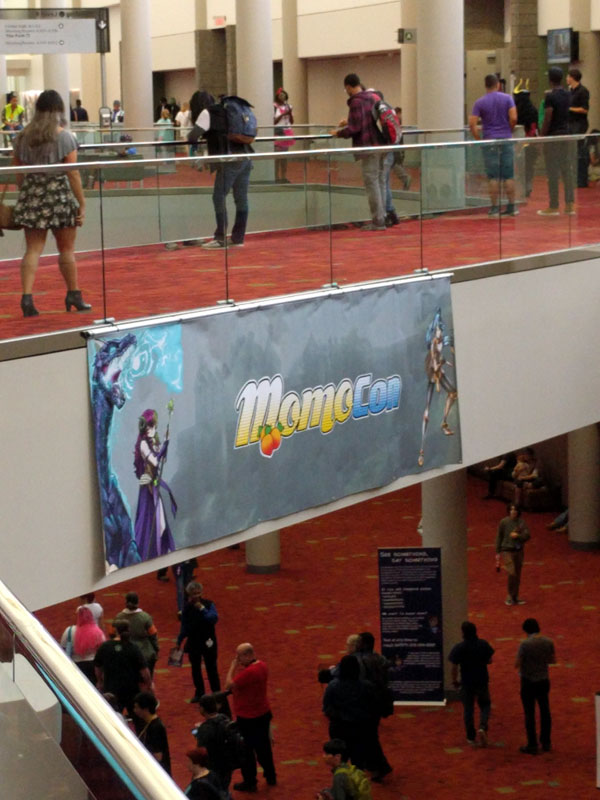 A shot of a banner for MomoCon and an overview of the GWCC layout