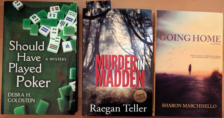 Three mystery books - Should have played poker, Murder in Madden, and Going home