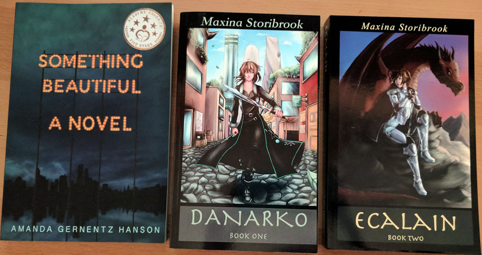 Three paperbacks - Something beautiful, Danarko, and Ecalain