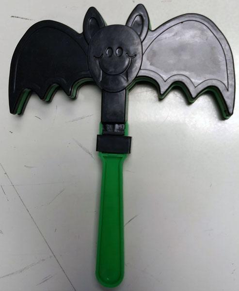 A plastic? bat noisemaker